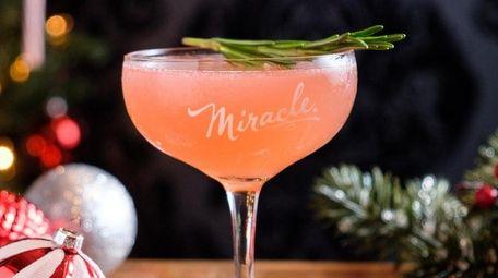 The Christmapolitan cocktail made with Vodka, elderflower, dry