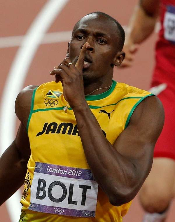Jamaica's Usain Bolt reacts as he wins the