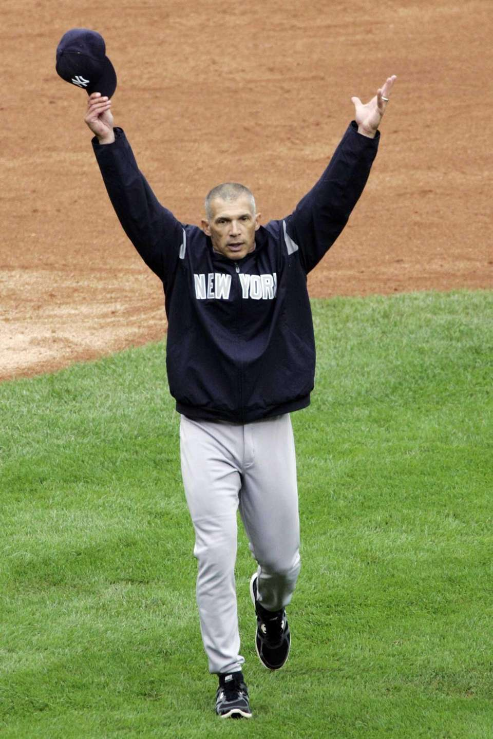Yankees manager Joe Girardi walks off the field
