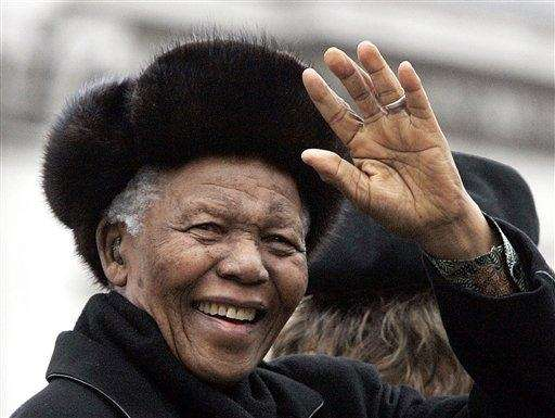 Nelson Mandela waves to the crowd in London's