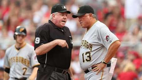 Brian Gorman the home plate umpire and Clint