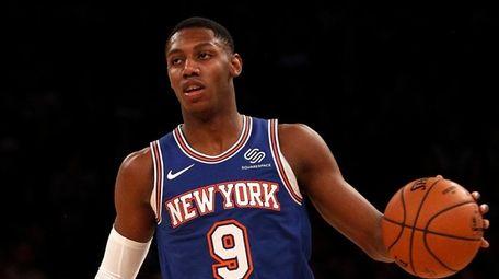 RJ Barrett of the Knicks controls the ball