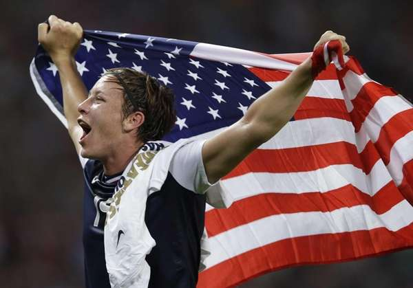 Team USA's Abby Wambach celebrates after her team