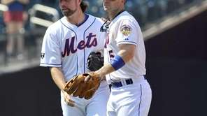 R.A. Dickey and David Wright walk off the