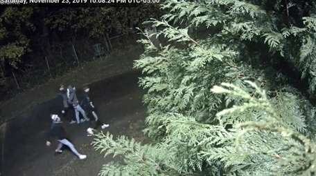 An image from surveillance video shows four people