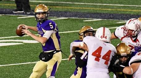 Sayville quarterback Jack Cheshire passes the football for