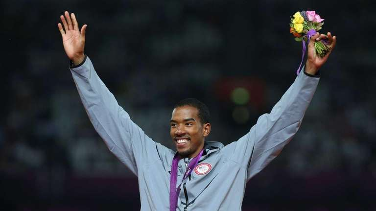 Gold medalist Christian Taylor of the United States