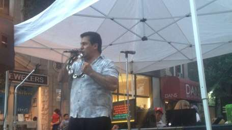Sal Vivo, 49, performs at Great Neck Plaza's