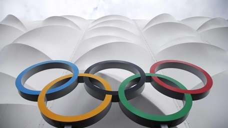 The Olympic rings displayed outside the basketball arena