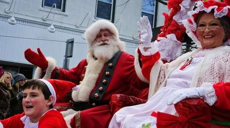 Santa rides down on a float during the