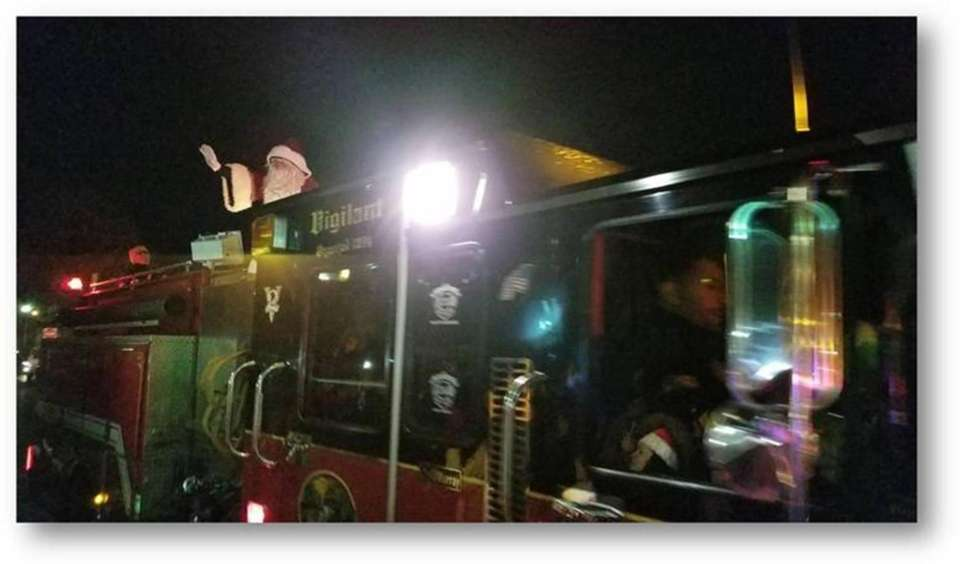 Santa arrives on a fire truck at the