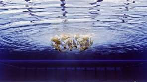 The team from China competes during the synchronized