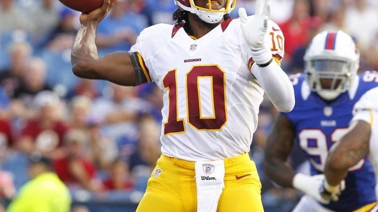 Washington Redskins quarterback Robert Griffin III throws during