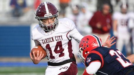 Garden City quarterback Luke Schmitt looks for running