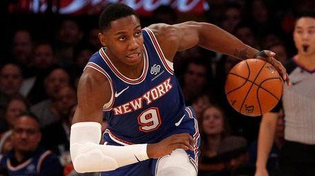 RJ Barrett of the Knicks heads upcourt after
