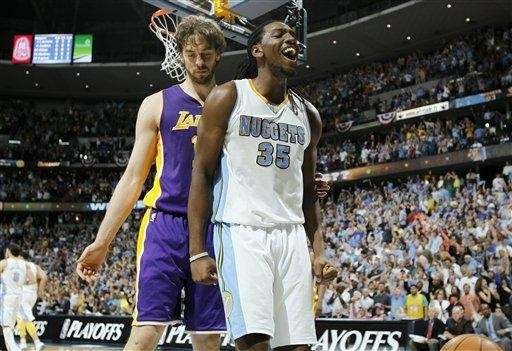 Denver Nuggets rookie forward Kenneth Faried, right, reats