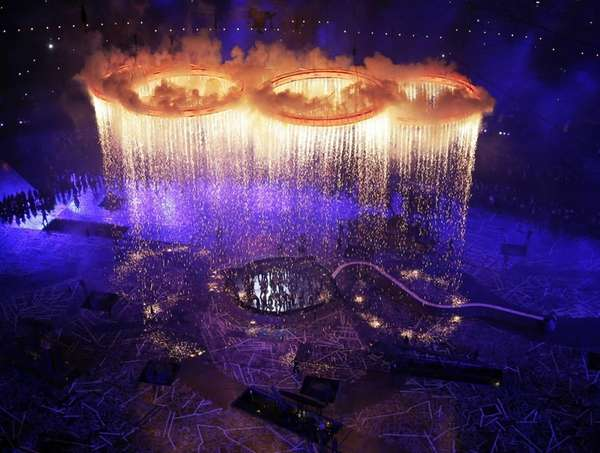 Olympic rings light up the stadium during the