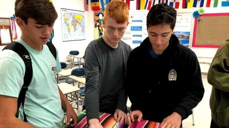 Sayville High School students play a traditional Tunisian