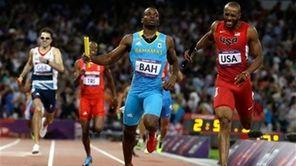 Bahamas' Ramon Miller beats United States' Angelo Taylor