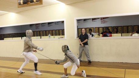 Adam Mandel, 20, of White Plains, (left) duels