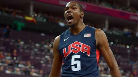 Kevin Durant reacts after a breakaway dunk during