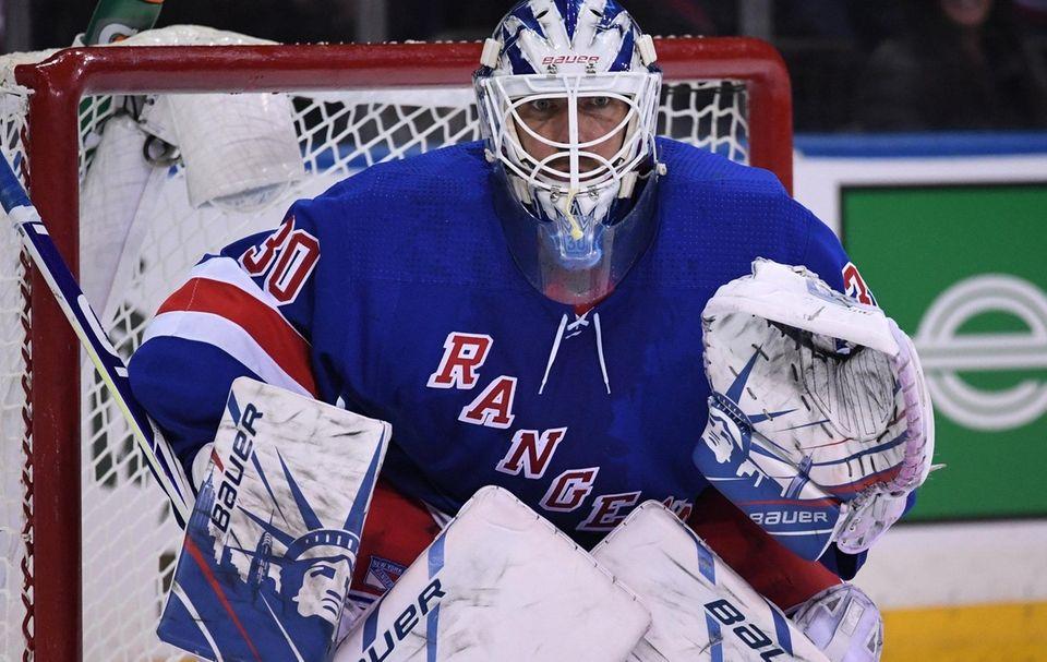 Rangers goaltender Henrik Lundqvist protects the net against