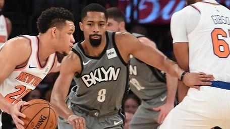 Nets guard Spencer Dinwiddie defends Knicks guard Kevin