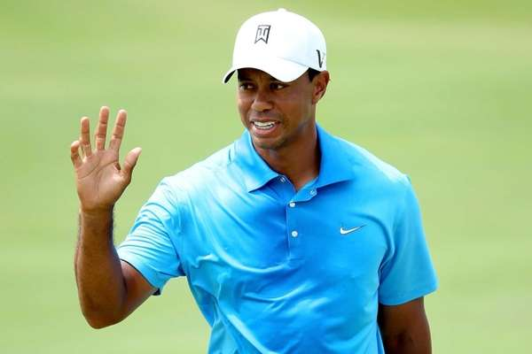 Tiger Woods reacts after making a putt on