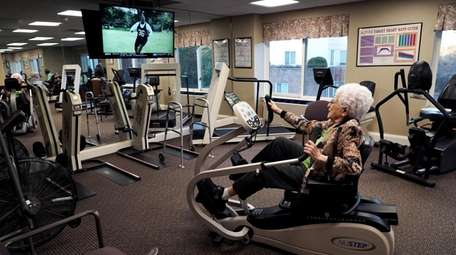 Gloria Potaznick works out on an exercise bike