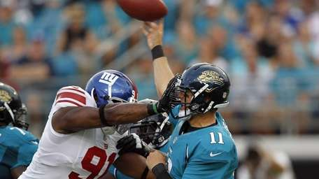 Jacksonville Jaguars quarterback Blaine Gabbert (11) is hit
