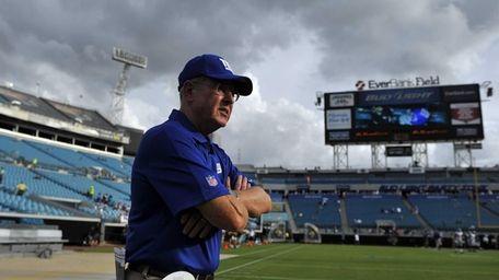 Giants head coach Tom Coughlin watches his team