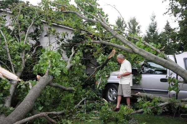 Bob Hohenberger surveys damage to his home and