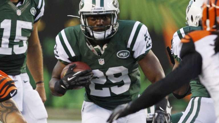 Jets running back Bilal Powell (29) carries against