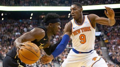 Toronto Raptors' Terence Davis (left) drives at Knicks'