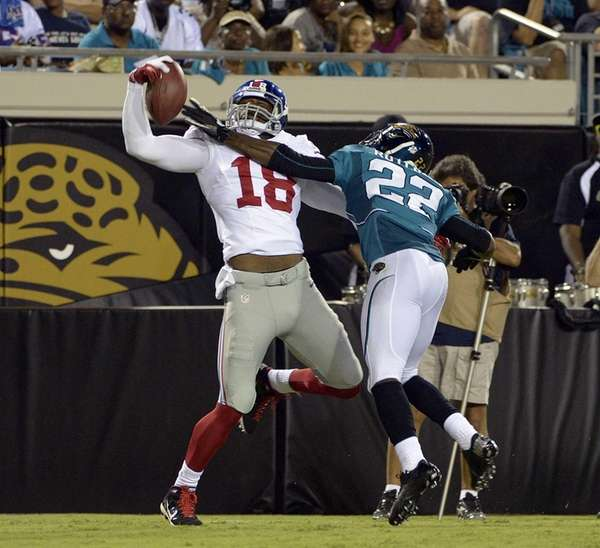 Giants wide receiver Isaiah Stanback (18) makes a