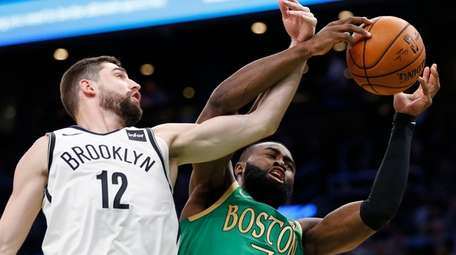 Boston Celtics' Jaylen Brown (7) and Brooklyn Nets'