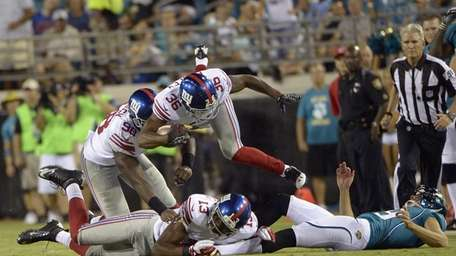 New York Giants cornerback Jayron Hosley (36) jumps