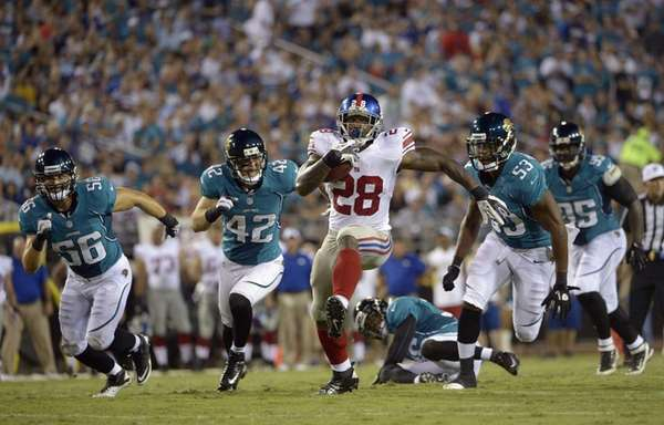 Giants running back D.J. Ware (28) breaks away