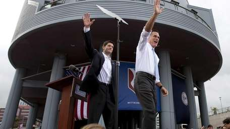 Republican presidential candidate Mitt Romney, right, introduces his
