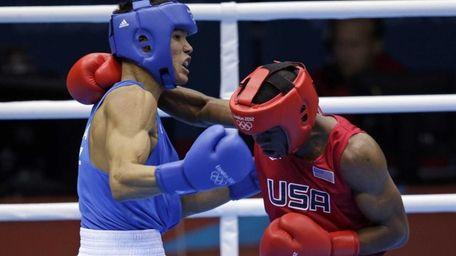 United States' Jamel Herring, right, fights Kazakhstan's Daniyar