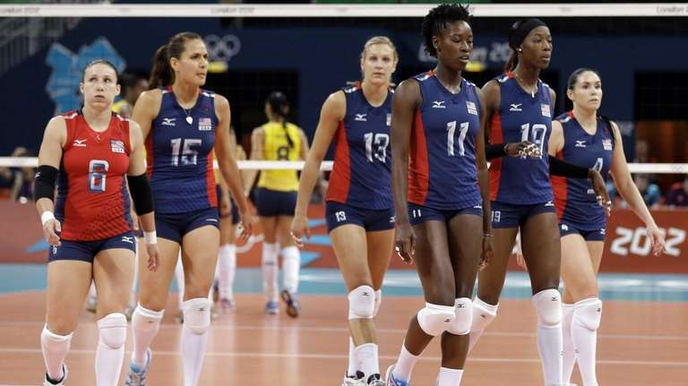 Members of the USA women's volleyball team walk