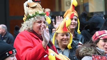 Spectators enjoy the Macy's Thanksgiving Day Parade on