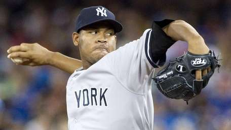 Yankees starting pitcher Ivan Nova pitches during a