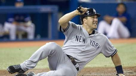 Mark Teixeira safely slides home to score on