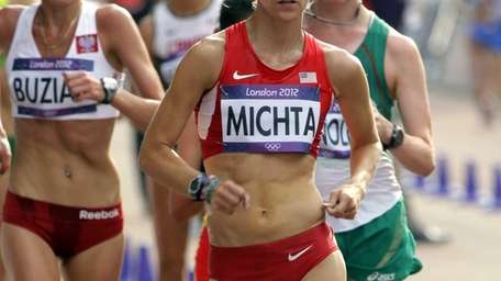 Maria Michta of the United States, center, competes