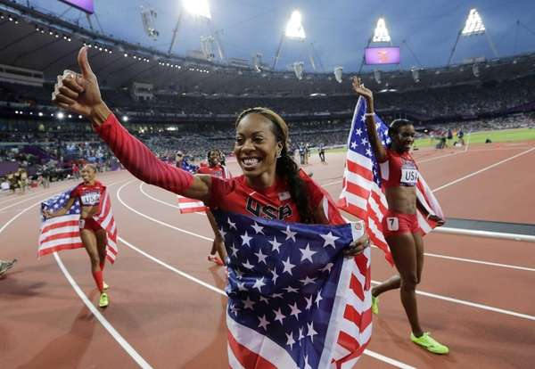 Deedee Trotter, right, Sanya Richards-Ross, front center, and