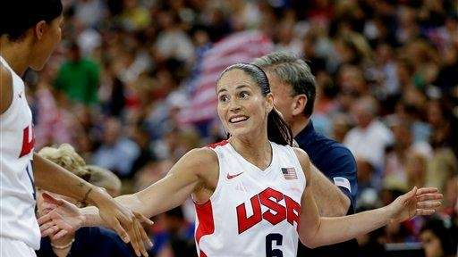 Sue Bird celebrates a basket against France during