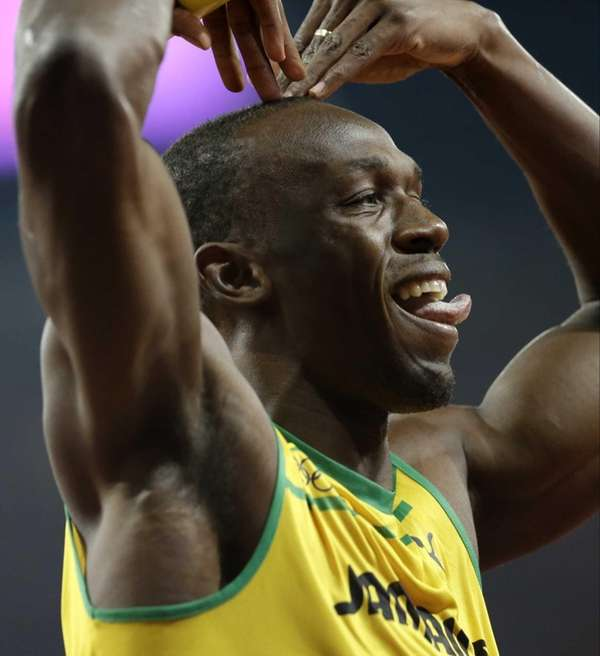 Jamaica's Usain Bolt celebrates his win in the