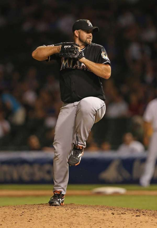 Heath Bell of the Miami Marlins pitches during