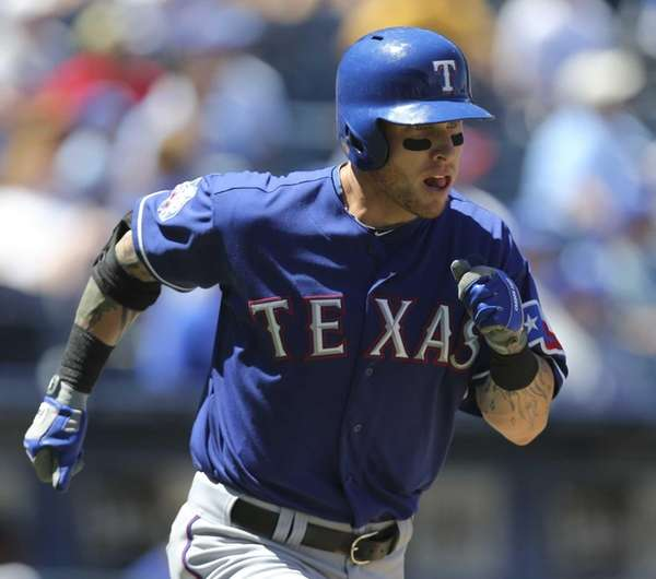 Josh Hamilton of the Texas Rangers runs out